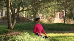 woman practicing meditation outdoors - stock footage