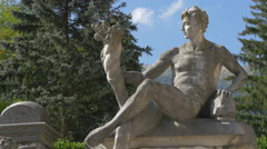 Male sculpture in the garden of Peles Castle - stock footage