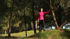 young women doing streching exercising in the park - stock footage