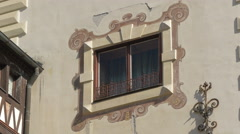 Ornate window and a wrought iron decoration on the facade of Peles Castle - stock footage