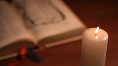 An open blurry bible with a rosary on background Stock Footage