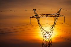 Power line at sunset Stock Photos