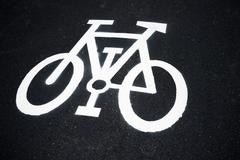Bike lane sign painted on a street - stock photo