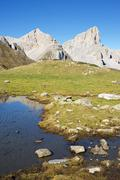Peaks and Ansabere Lake. Lescun Cirque. Aspe Valley, Pyrenees, France. - stock photo