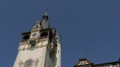 Hand-painted murals on the clock tower of Peles Castle - stock footage
