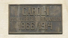 Inscription at King Carol I statue, Peles Castle - stock footage