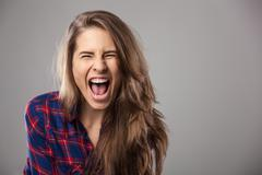Young woman screaming loudly. - stock photo