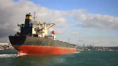 Stern and funnel of an empty tanker ship sailing into the sea under blue sky Arkistovideo