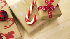 Christmas gifts wrapped in brown paper with red ribbons. Stock Footage