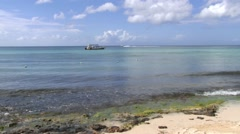 View to the calm sea waves and boat in La Romana, Dominican Republic. Stock Footage