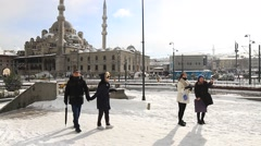 Tourists enjoy themselves who often have never seen snow before in Istanbul Stock Footage