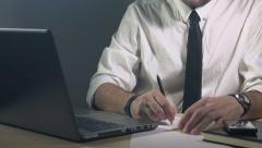 Businessman writing project plan notes, working at home Stock Footage