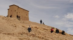 Ait Benhaddou and tourists on the top fortress time lapse Stock Footage