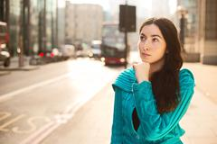 young woman with a serious expression - stock photo