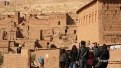 Ait Benhaddou, moroccan ancient fortress and tourists Stock Footage
