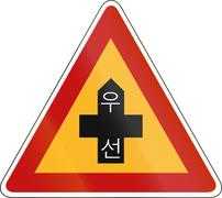 Korea Traffic Safety Sign - Attention - Priority Road. The script means prior - stock illustration