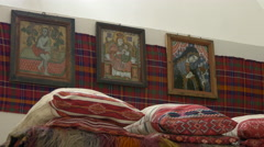 Religious icons, folk pillows and fabric at the museum, in Fagaras fortress - stock footage