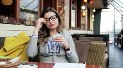Businesswoman taking off glasses and start relaxing in the cafe Stock Footage
