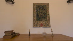 Stock Video Footage of Desk with old books, two lamp stands and a decorative rug in Fagaras fortress