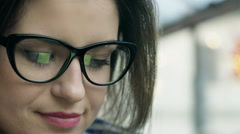 Businesswoman wearing glasses and looking worried in the cafe Stock Footage
