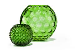 antique green round dimple effect vase - stock photo