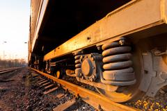 Rusty old wheel of a freight train standing on the tracks - stock photo