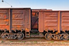 part of a long freight train is on the tracks - stock photo