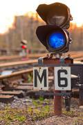 A semaphore on railway lit blue light Stock Photos