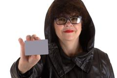 Stock Photo of mature adult woman with a card in hand