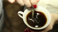 Woman stirs coffee, close-up Stock Footage