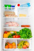 Stock Photo of shelf of the refrigerator with food