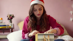 Happy teenager open her present and smiling to the camera, steadycam shot Stock Footage