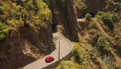 Car on a twisting road on Madeira, Portugal Stock Footage