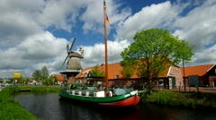 Ostgrossefehn, ship and windmill Stock Footage