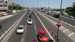 Moving traffic in-city highway at noon from above Stock Footage