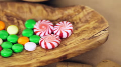 Stock Video Footage of Decorating gingerbread house with royal icing and colorful candies.