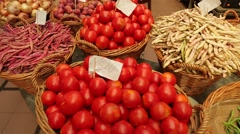 Vegetables in baskets on a market Stock Footage