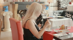 Charming blonde drinking latte in a cafe Stock Footage