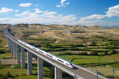 View of a high-speed train crossing a viaduct in Roden, Zaragoza, Aragon, Spain Stock Photos