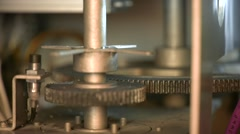 Technological line of spill of yogurt. close-up shot of the rotating gears Stock Footage