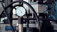 Technological line of spill of yogurt. pressure manometer close-up shot - stock footage