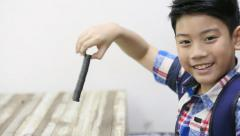 Happy asian boy playing magnet on the table . Stock Footage
