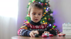 Stock Video Footage of Adorable little preschool boy, playing with toy cars at home on Christmas, Ch