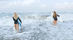 Surf Girls Going Into Ocean slow motion Stock Footage