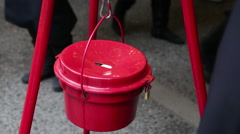 Man donating money to Salvation Army Charity Bucket manhattan NYC XMAS - stock footage