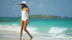 Ethnic Hispanic female in white swimsuit and sunhat on vacation beach - stock footage