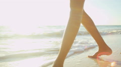Legs of a Latin American girl wearing white sundress on vacation beach Stock Footage