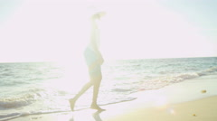 Ethnic Hispanic female in white swimsuit and sunhat on vacation beach Stock Footage