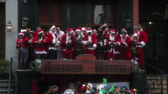 Crowd of People dressed as Santa Claus at Christmas during Santacon NYC Stock Footage