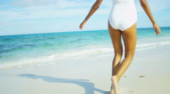 Legs of barefoot Latin American female in swimsuit on vacation beach Stock Footage